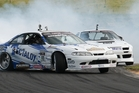 Gaz Whiter leads Andrew Redward in the first round of the 2013/14 D1NZ National Drifting Championship.Photo/Erron Soon