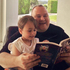 Kim Dotcom reading with his daughter Kimmo. Photo / twitter.com/KimDotcom