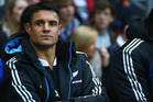 Dan Carter sits injured on the bench during the QBE International match between England and New Zealand at Twickenham. Photo / Getty Images
