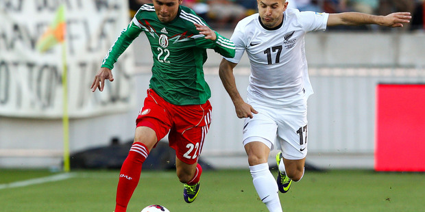 Paul Aguilar of Mexico and Kosta Barbarouses of New Zealand compete for the ball during tonight's game. Photo / Getty Images