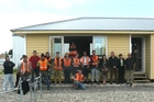 FROM SCRATCH: Nga Kanohi Marae o Wairarapa Trades Training graduates, tutors and supporters in front of the three-bedroom home students built from scratch that was sold to Martinborough buyers.
