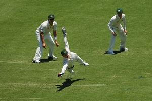 Brad Haddin dives to stop a ball down the leg side. His 94 helped salvage Australia's innings. Photo / Getty Images