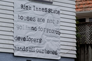 A sign on a home protesting against the selling of state houses to developers. Photo / Brett Phibbs