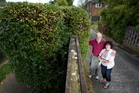 Peter and Angela Signal have been told the council did not plant the public hedge and won't maintain it. Photo / Sarah Ivey