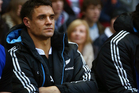 Dan Carter of New Zealand sits injured on the bench during the QBE International match between England and New Zealand. Photo / Getty Images.