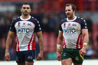 Greg Inglis, left, of Australia alongside Clint Newton, right, of USA at the final whistle during the Rugby League World Cup Quarter Final match between Australia and USA. Photo / Getty Images