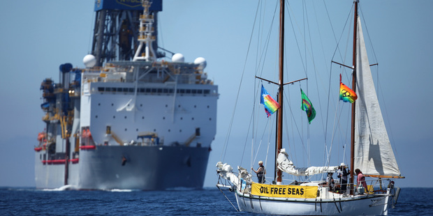 SV Vega confronts the Noble Bob Douglas drilling ship on the site where oil giant Anadarko intends to start exploratory drilling for deep sea oil. The drill site is over 100 nautical miles off Raglan,