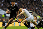 Charles Piutau of New Zealand breaks past Mike Brown of England during the QBE International match between England and New Zealand at Twickenham Stadium. Photo / Getty Images.