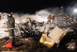 Emergency services working at the site of the plane crash near Kazan. Photo / AFP