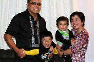 Dennis Maga with son Elijah, 7, Rua, 3, and wife Amie.