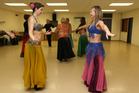 Rachel Grunwell gets a belly-dancing lesson from Candice Frankland. Photo / Getty Images