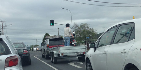 Guy on Lunn Ave, Mt Wellington, standing in a trailer balancing a scooter ... As you do!