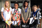 From left, girls division winner Elin Tawharau and second placed Kea Smith, both of Mount Maunganui, with fellow finalists Zhana Hutchieson and Ariana Shewry. Photo / Surfing NZ.
