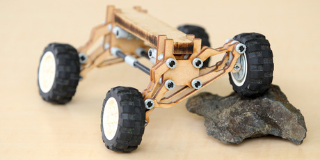 A model shows the Tahr Quad self-levelling suspension, which will improve safety when sidling around hills by keeping the laden vehicle's centre of gravity between the axles.