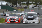 Nick Ross (left) and Jason Bargwanna side-by-side as they battled for victory at Pukekohe.Picture / Geoff Ridder