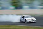 Gaz Whiter smokes the competition at the opening round of D1NZ at Hampton Downs. Picture / Blake Lewis