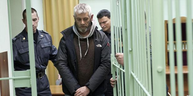 Activist David Haussmann, from New Zealand, arrives for his bail hearing, at a court in Murmansk, Russia. Photo / AP