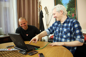 Rene Perez Joglar, better known as Residente from the Latin music group Calle 13, left, and WikiLeaks founder Julian Assange. Photo / AP