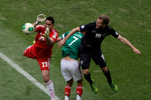 Mexico's goalkeeper Moises Alberto Munoz grabs the ball under pressure from Jeremy Brockie during last week's game. Photo / AP