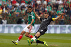 Mexico's Raul Jimenez, left, fights for the ball with New Zealand's Tommy Smith during the 2014 World Cup playoff first round soccer match in Mexico City. Photo / AP