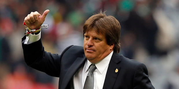 Mexico's head coach Miguel Herrera gives a thumb up as he leaves the pitch after Mexico defeated New Zealand 5-1 during the first round of a 2014 World Cup playoff against New Zealand. AP
