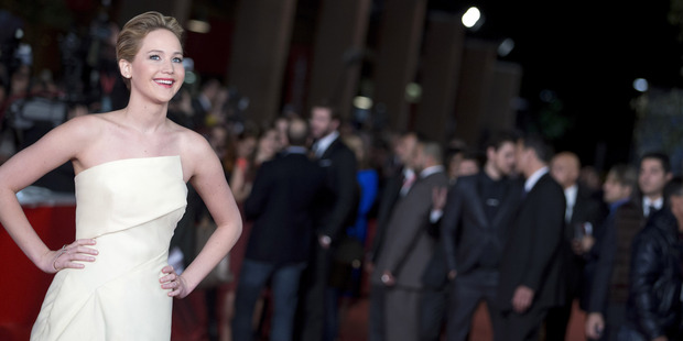 Actress Jennifer Lawrence poses for photographers as she arrives for a screening of The Hunger Games: Catching Fire. Photo / AP