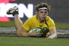 Australia's Michael Hooper scores a try against Ireland during their Rugby International at the Aviva Stadium, Dublin, Ireland, Saturday, Nov. 16, 2013. (AP Photo/Peter Morrison)