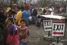 Typhoon Haiyan survivors queue up to get into any evacuation flight at the airport in Tacloban, Philippines. Photo / AP