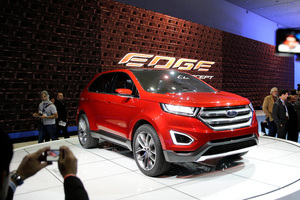 People take pictures of the new Ford Edge concept vehicle at the Los Angeles Auto Show. Photo / AP
