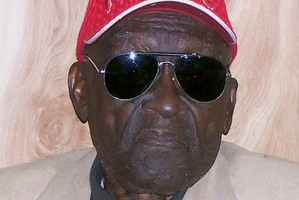 Monroe Isadore poses for photos on his 105th birthday in Pine Bluff, Ark.