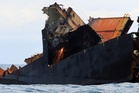 The ship has been stuck on the reef since its dramatic grounding there in the early hours of October 5, 2011. Photo / Bay of Plenty Times