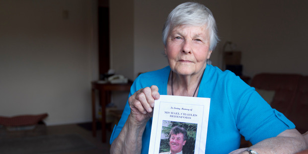 Barbara Beresford with a photo of her son Michael Beresford.