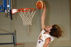 Klay Rouse goes up for a slam dunk against Muriwhenua.Photo / Ron Burgin.