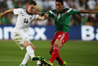 Storm Roux of New Zealand competes with Aldo De Nigris Guajardo of Mexico during leg 2 of the FIFA World Cup Qualifier match between the New Zealand All Whites and Mexico. Photo / Getty Images.