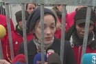 Oscar-winning actress Marion Cotillard briefly caged herself near Paris's Louvre museum to demand the freeing of 30 Greenpeace activists jailed in Russia over an Arctic protest.