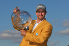 Adam Scott holds the trophy aloft after winning the Australian Masters at Royal Melbourne Golf Course. Photo / Getty Images