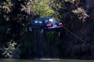 The car involved in the incident on Sunday was lifted from the Waikato River yesterday. Photo / Christine Cornege