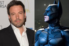 Ben Affleck, left, and Christian Bale playing Batman. Photo / AP / Supplied