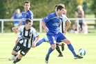 Bay United's Fergus Neil chases Southern United's George Mansford.
