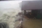 Shocking eyewitness footage has emerged of Typhoon Haiyan, showing a huge wave wiping out a house. The clip was shot by a worker for the Plan International charity in the Philippines. Nickson Gensis was sheltering on the second floor of a house, in Hernani, Eastern Samar, and continued filming while other onlookers resorted to prayer.