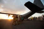 Aid is unloaded from a RNZAF C-130 Hercules at Guiuan airfield. Photo / RNZAF