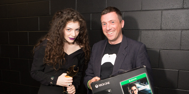 Lorde getting her Xbox One from Xbox New Zealand chief Steven Blackburn. Photo / Ollie Dale