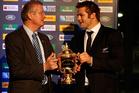 Richie McCaw hands the William Webb Ellis Cup back to iRB Chairman Bernard Lapasset. Photo / Getty Images