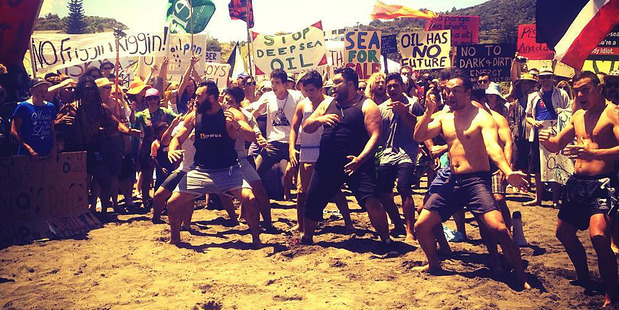 A haka is performed at the Piha protest against deep sea oil drilling. Photo / Greenpeace