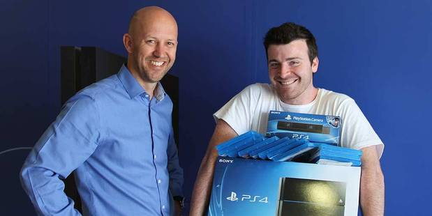 Playstation's Dave Hine, left, with competition winner Ari Blair.