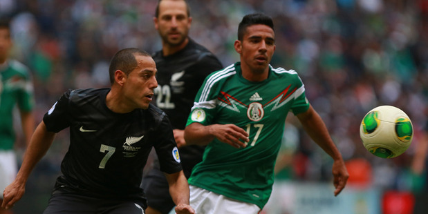 Jesus Escoboza of Mexico struggles for the ball with Leo Bertos of the All Whites. Photo / Getty Images