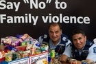 Sergeant Lehi Hohaia and Constable Peter Rameka with donations made by the Rotorua police and Bay of Plenty Police District Headquarters staff. Photo/Stephen Parker.