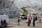 Two workers were killed after a crane collapsed on a stand at the Itaquerao Stadium in Sao Paulo causing it to buckle. Photo / AP