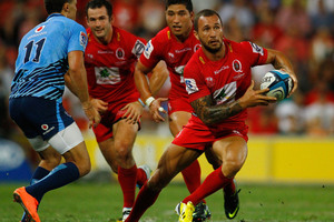 Quade Cooper runs with the ball in attack during the Super Rugby match between the Reds and the Bulls. Photo / Getty Images