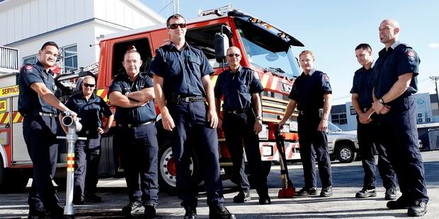 TEAM WORK: Whangarei Fire Service station officer Paul Foster (middle) with fellow firefighters who turned off the gas leak at Kamo after the bus crash. PHOTO/RON BURGIN